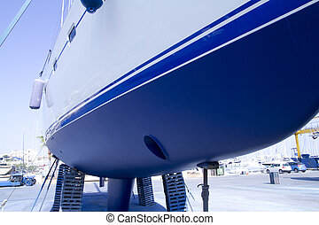 boat hull sailboat blue antifouling beached for paint works
