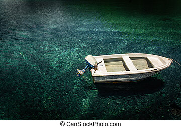 Boat in calm lake water.