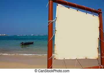 Boat in caribbean beach and sign. Tayrona, Caribbean, Colombi