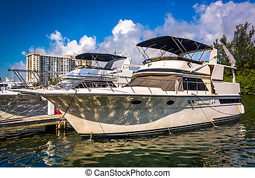 Boat in Collins Canal in Miami Beach, Florida. - Boat in...
