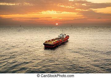 Boat in oilfield when moving