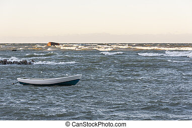 Boat in stormy sea