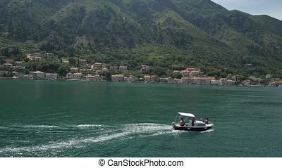 Boat in the Bay of Kotor. Montenegro, the water of the Adriatic