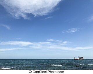 Boat in the blue sea with blue sky background
