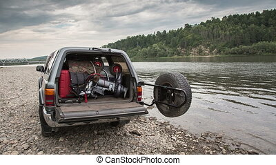 Boat in the car - pvc boat with outboard engine is packed in...