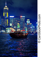 Boat in the city at night