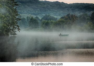 Boat in the morning fog