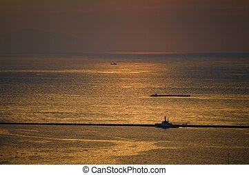 boat in the ocean sunset
