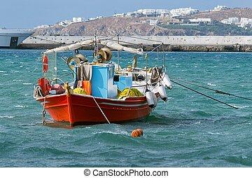 Boat in the port of Mykonos, Greece