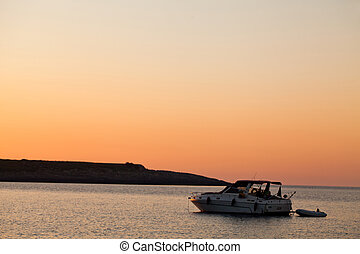 Boat In The Sea At Sunrise