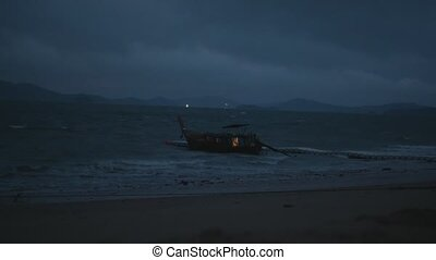 Boat in the sea over cloudy dark sky