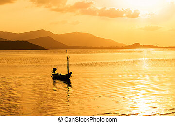 boat in the sea sunset background