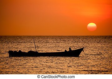 Boat in the sunset - cambodia
