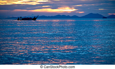 Boat in the sunset sea