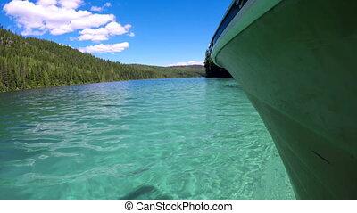 Boat in turquoise river 4k - Boat in turquoise river on a ...