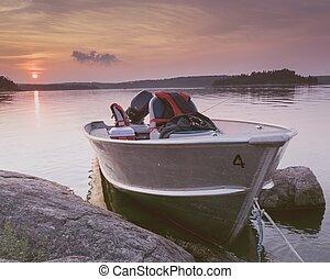 Boat In Water by the rocks