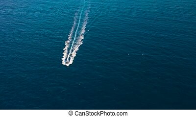 Boat launch at high speed floats in the Mediterranean sea,...