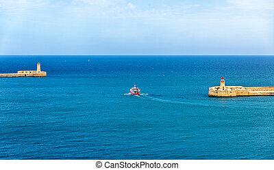 Boat leaving the port of Valletta - Malta