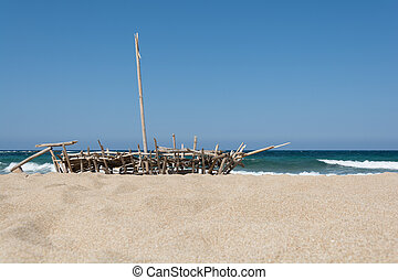 Boat made of reeds on the sand