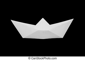 Boat made of white paper on a black background.
