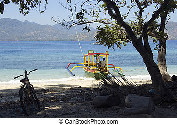 Boat, man and bike on Gili islands, Indonesia