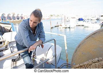 boat mechanic checking a car