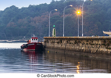 Boat moored at dusk