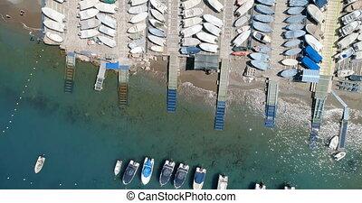 Boat moored at harbor 4k - Aerial view of boat moored at ...