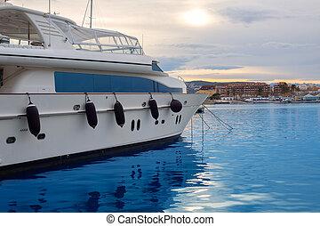 Boat moored in Mediterranean marina in Denia Alicante