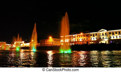 boat moves along Moscow River near beautiful lighted fountain