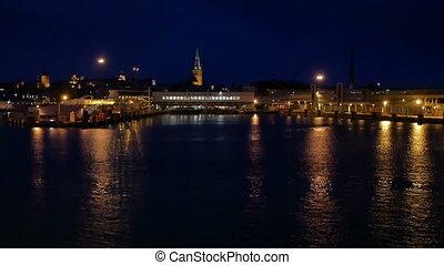 Boat moves night city sea