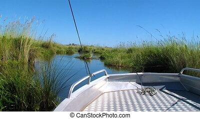 Boat navigating clear blue sky
