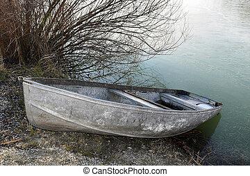 Boat near frozen lake