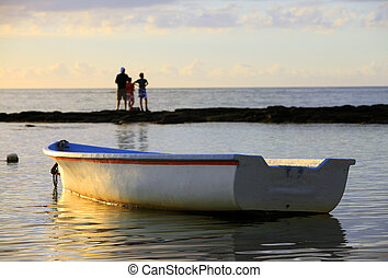 Boat near the beach at sunset