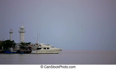 Boat near the lighthouse - A beautiful boat is near the...