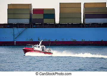 Boat of port pilots compared to cargo container