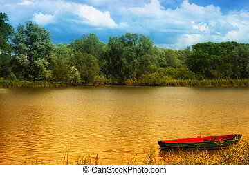 Boat on a golden pond - Red rowing boat on a golden pond...