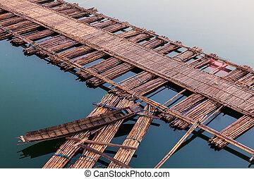 Boat on bamboo bridge