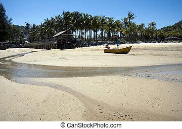 Boat on beach at low tide, Bang Tao, Phuket, Thailand