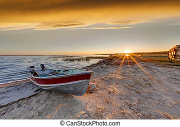 Boat on Beach at Sunrise Over Buffalo Lake, Alberta