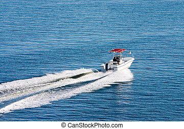 Boat on calm day2 - A boat underway in calm waters upper...