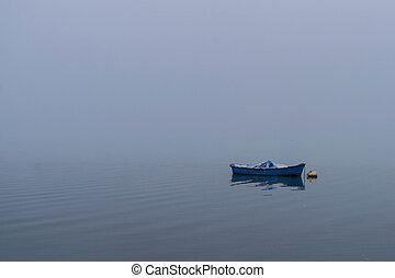 Boat on calm lakae water.
