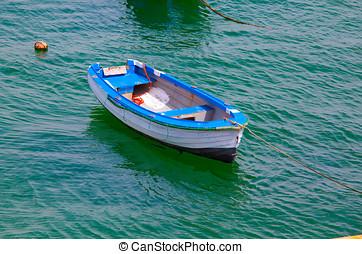 Boat on calm sea  in Cascais Bay, Cascais, Portugal