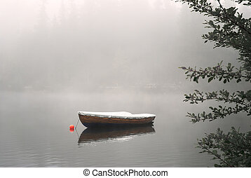 Boat on Foggy Lake