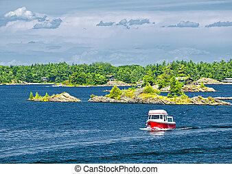 Boat on Georgian Bay - Small boat on lake near island in ...