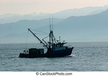 Boat on Katchemak Bay - A small boat heads into the foggy ...
