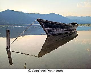 Boat on Lake at Sunset