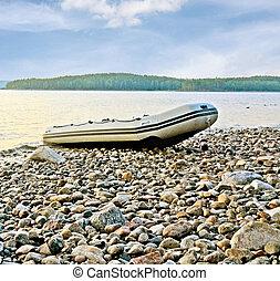 Boat on lake beach
