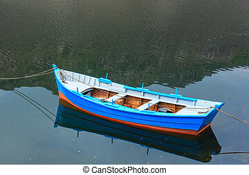 Boat on lake water surface.