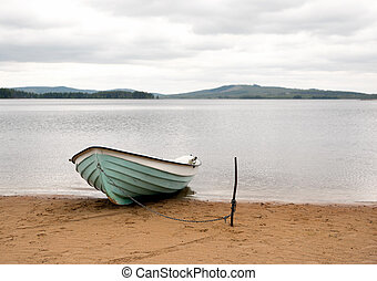 Boat on sandy beach - Close up of boat moored on sandy beach...